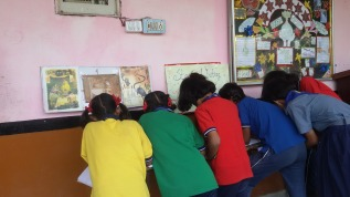 Students are writing story on given picture